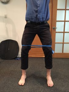 Theraband squats 225x300 1 - 5 Tips For Pain-free Squatting